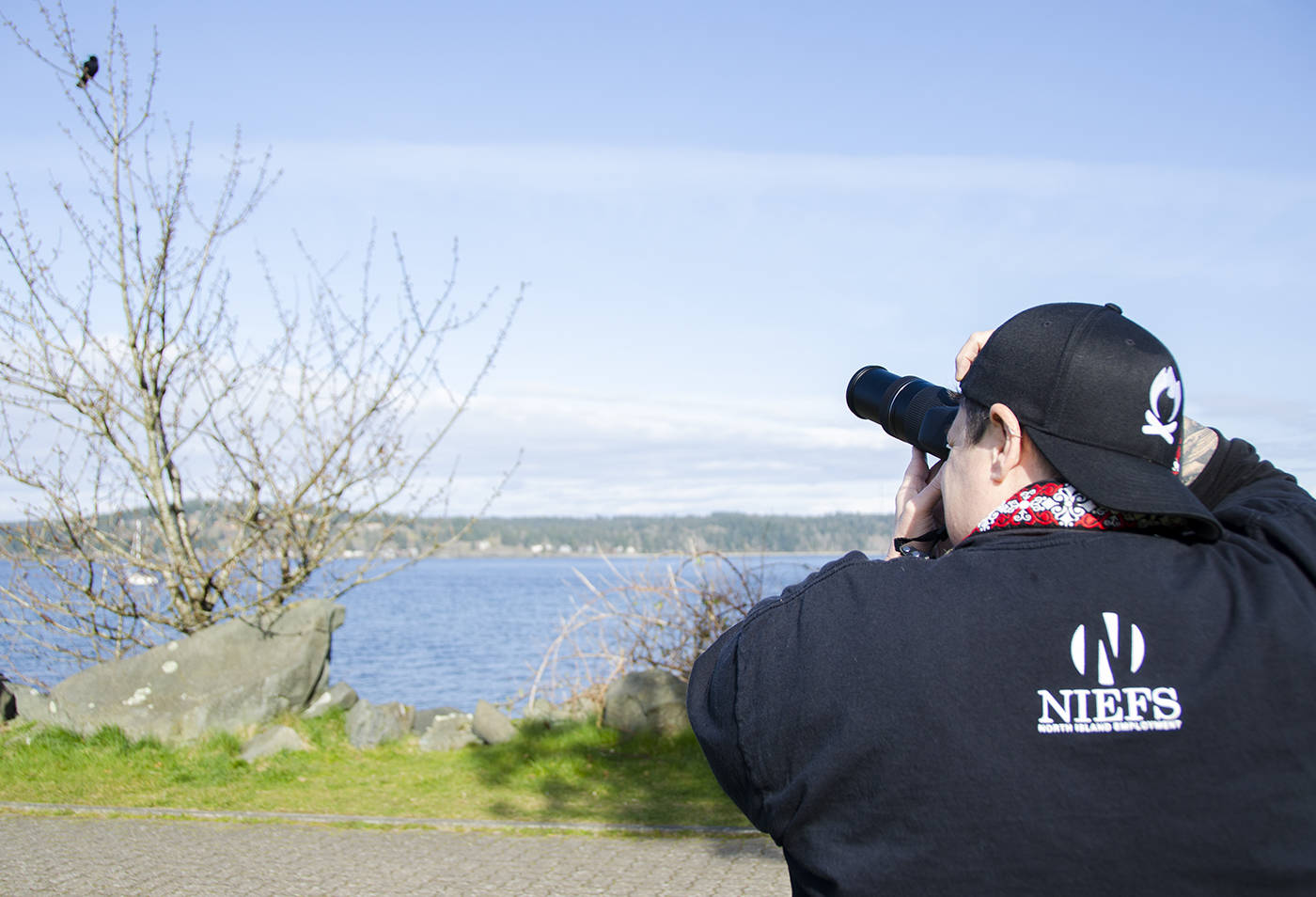 Colleen Wilson, otherwise known as The Crowtographer, adds some photos to her collection one day after work recently down at Robert Ostler Park. Wilson has garnered over 11,000 followers on Instagram and over 21,000 on Facebook by sharing her hobby online. Photo by Mike Davies/Campbell River Mirror