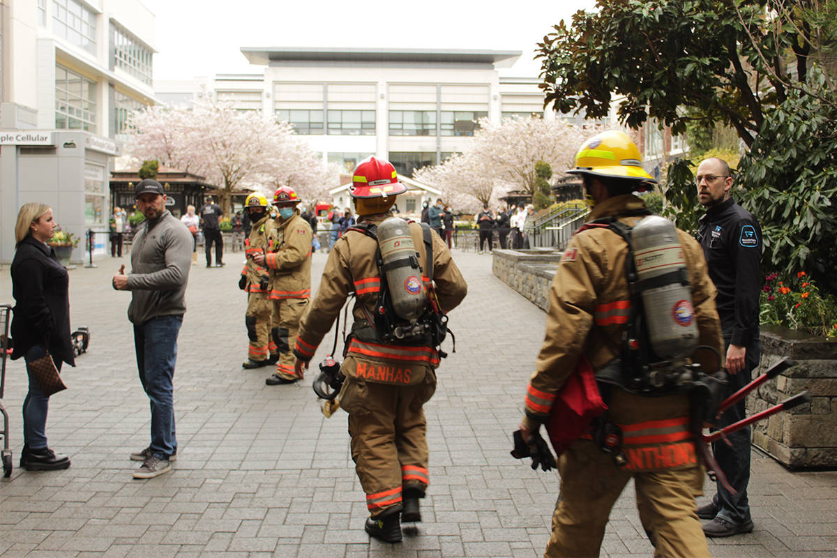 Firefighters respond to a report of an 'explosion' April 9 at Uptown Walmart. The call turned out to be a car driven through a wall and 20 feet into the deli area of the store. (Devon Bidal/News Staff)