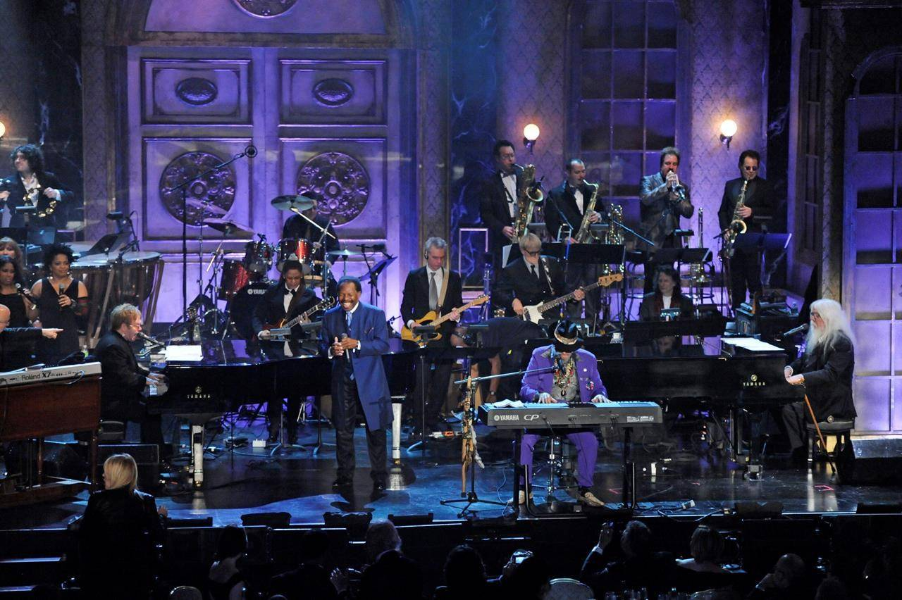 From left, Elton John, Lloyd Price, Dr. John, and Leon Russell perform at the Rock and Roll Hall of Fame induction ceremony in New York. (AP Photo/Evan Agostini)
