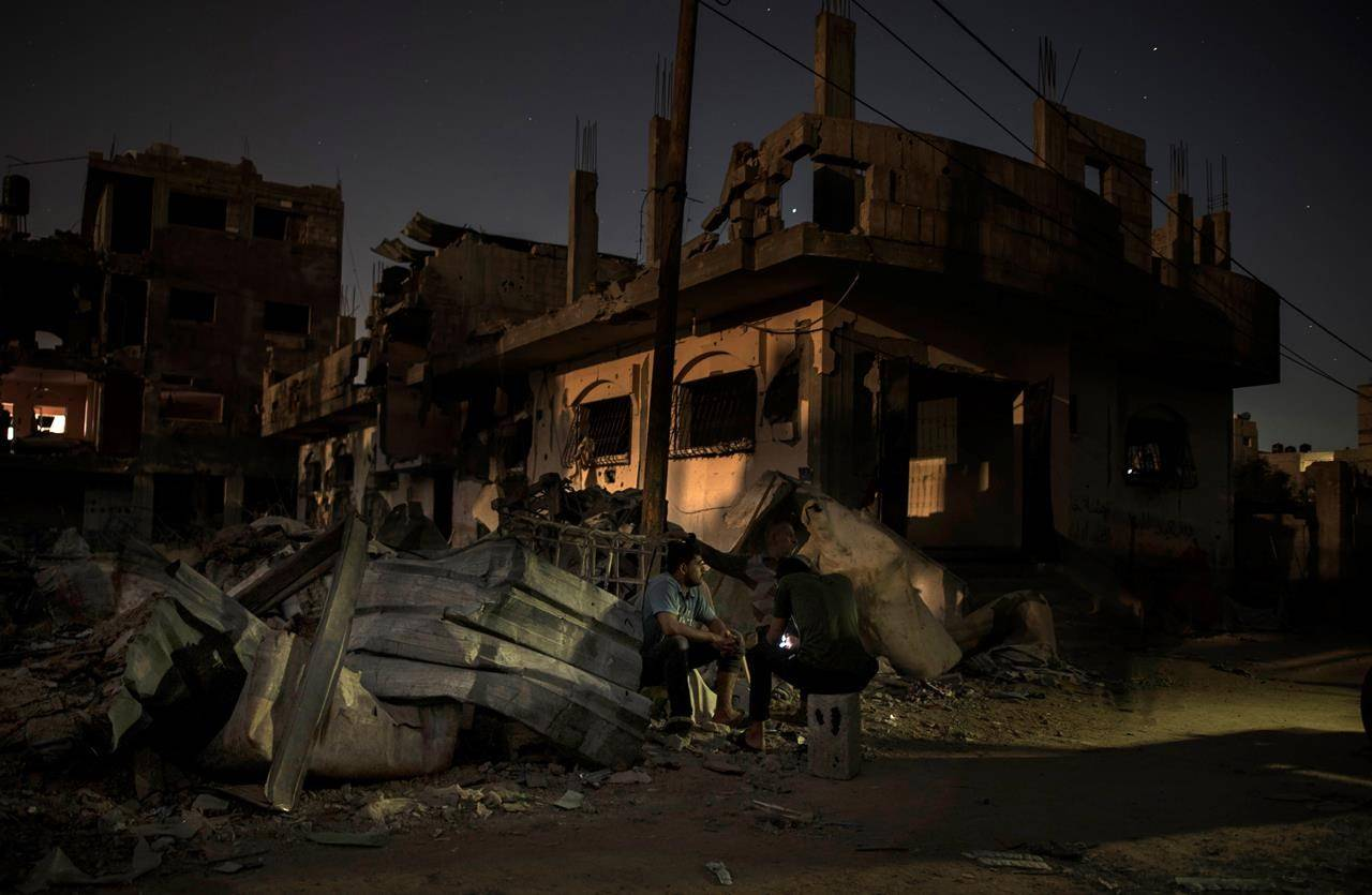 Palestinians spend the night next to their destroyed homes that were hit recently by Israeli air strikes in the town of Beit Hanoun, northern Gaza Strip, Wednesday, May 26, 2021. THE CANADIAN PRESS/AP -Khalil Hamra
