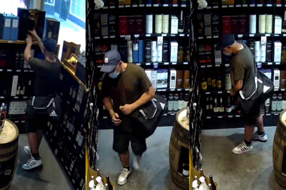 Oak Bay police issued these surveillance images after a theft from the Cork & Barrel liquor store. The bottle of stolen whisky was valued at $4,636.99. (Courtesy Oak Bay Police Department)
