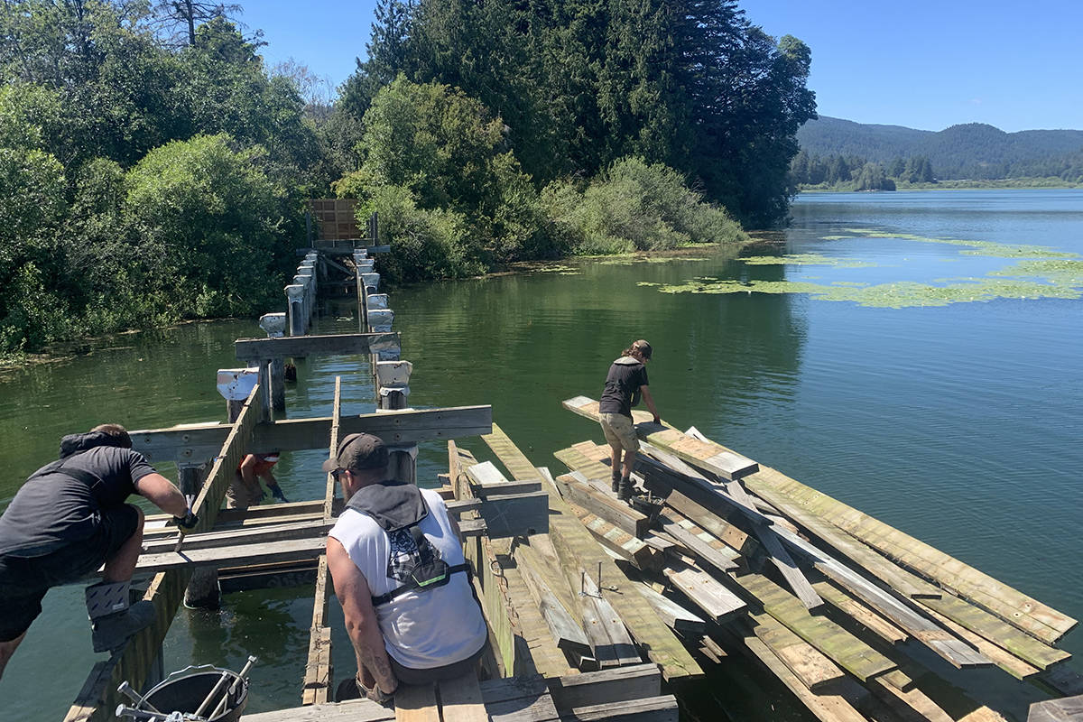 Crews work on a portion of the Ed Nixon Trail boardwalk. (Photo courtesy of Murray McKay)