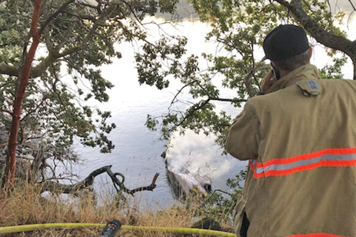 Saanich firefighters were called to the Gorge Waterway early Tuesday (Sept. 7) morning to extinguish a fire on a boat anchored just off shore. (Photo courtesy Saanich Fire Department)