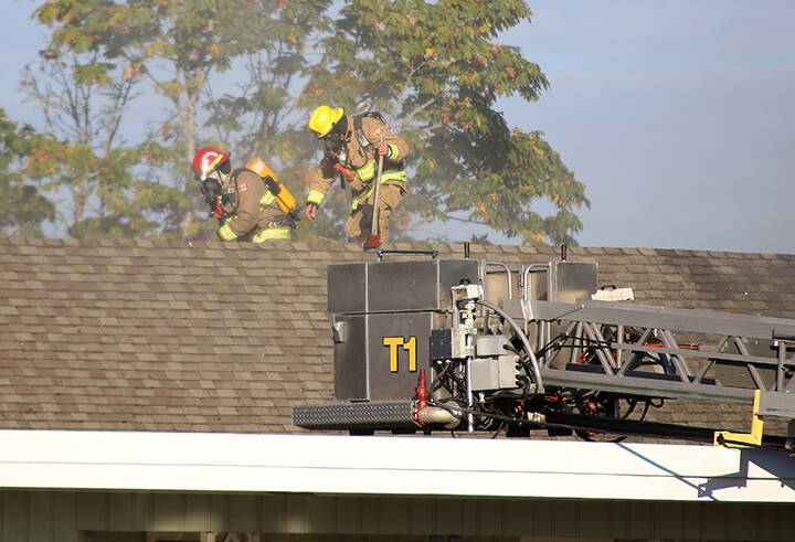 Firefighters cut into the roof of the Brae Road Gospel Chapel while trying to extinguish a fire on Tuesday morning. (Kevin Rothbauer/Citizen)