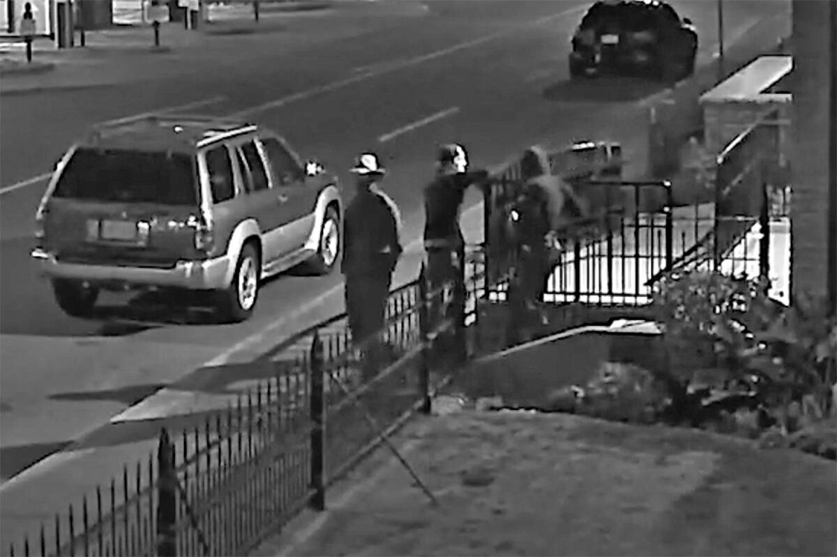 Victoria police have released security camera footage of suspects (right) in the vandalizing of St. Andrew's Cathedral on Sept. 12. The individual in the broad white hat (left) is considered a witness whom police also want to speak with. (Photo courtesy of VicPD)
