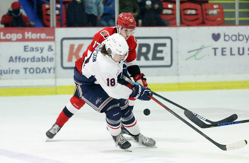 Cowichan Valley Capitals forward Colten Thompson battles an Alberni Valley Bulldogs player for the puck during the Caps' season opener at the Cowichan Arena last Saturday night. (Kevin Rothbauer/Citizen)