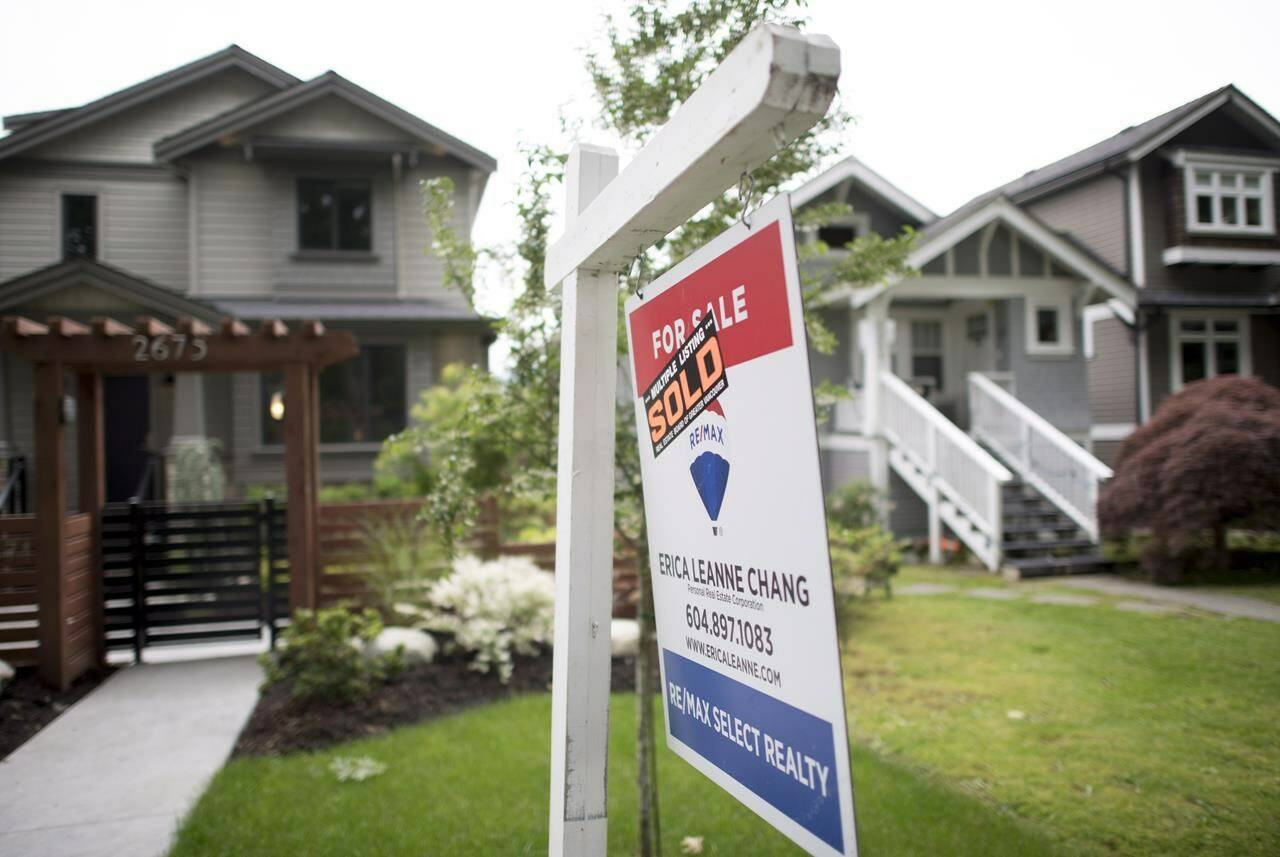 A real estate sign is pictured in Vancouver, B.C., on June 12, 2018. THE CANADIAN PRESS Jonathan Hayward